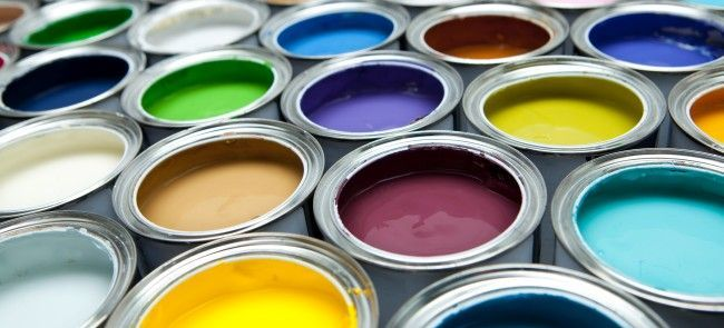 open cans of colorful paint