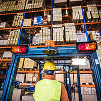 Man in distribution warehouse