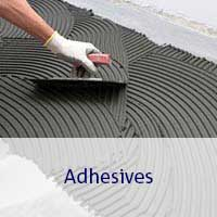 hand spreading tile adhesive