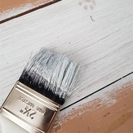 Wooden floor with paint brush