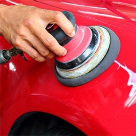 Man buffing a red sports car