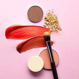 Eye shadow, lip stick, and brush used for makeup