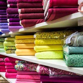 racks of colorful fabric reams
