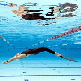 Swimmer swimming in recreational pool