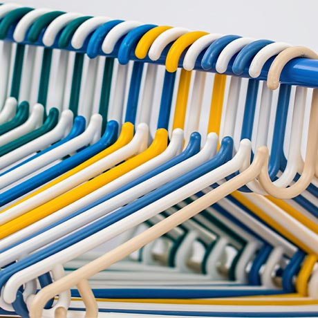 Plastic clothes hangers on rod