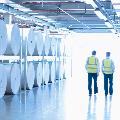 workers walking in a paper plant