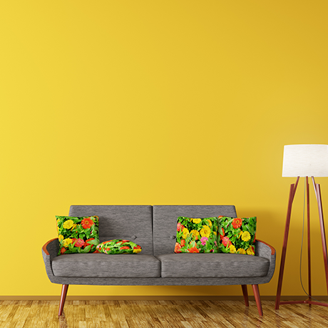 Fabric sofa against painted yellow wall