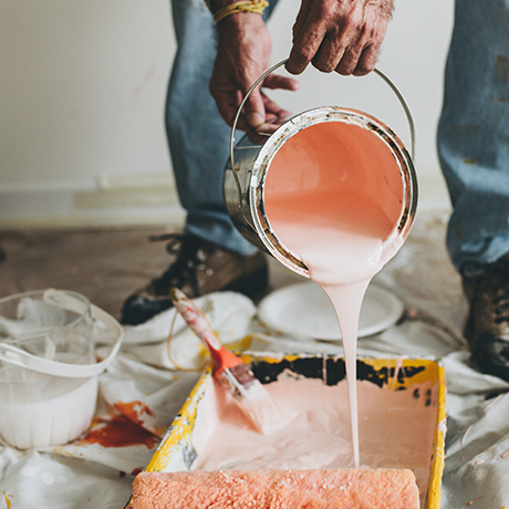Man pouring pink paint