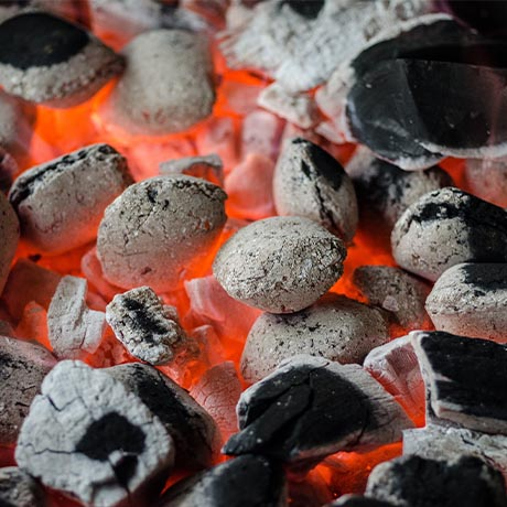 BBQ pit with burning charcoal