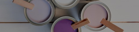 Pink, purple, lavender, and white paint cans