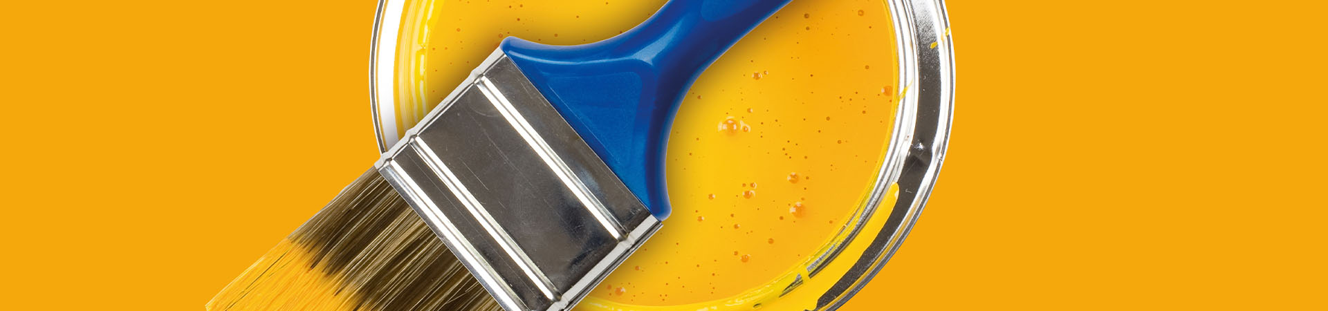 Bright yellow paint with blue paint brush