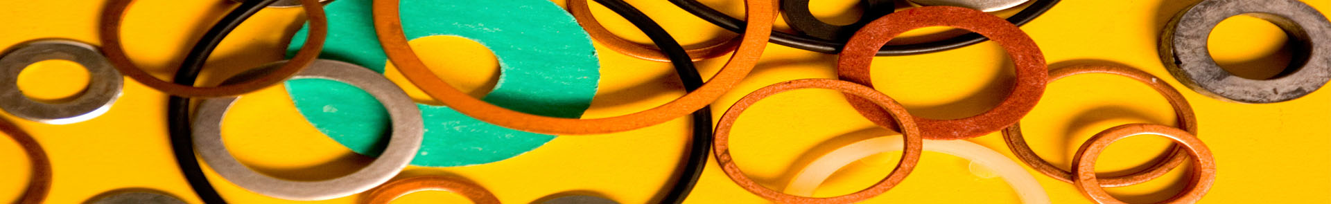 Colored rings on a yellow surface