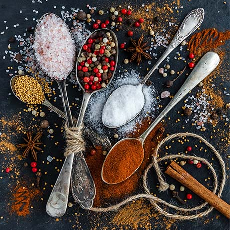 Spices and salt on spoons