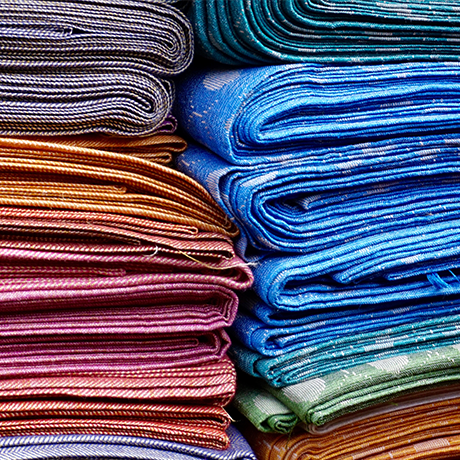 Colorful textile cloths laid on top of each other