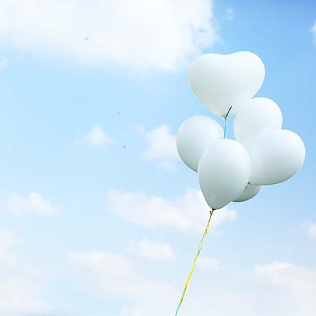 White balloons in sky