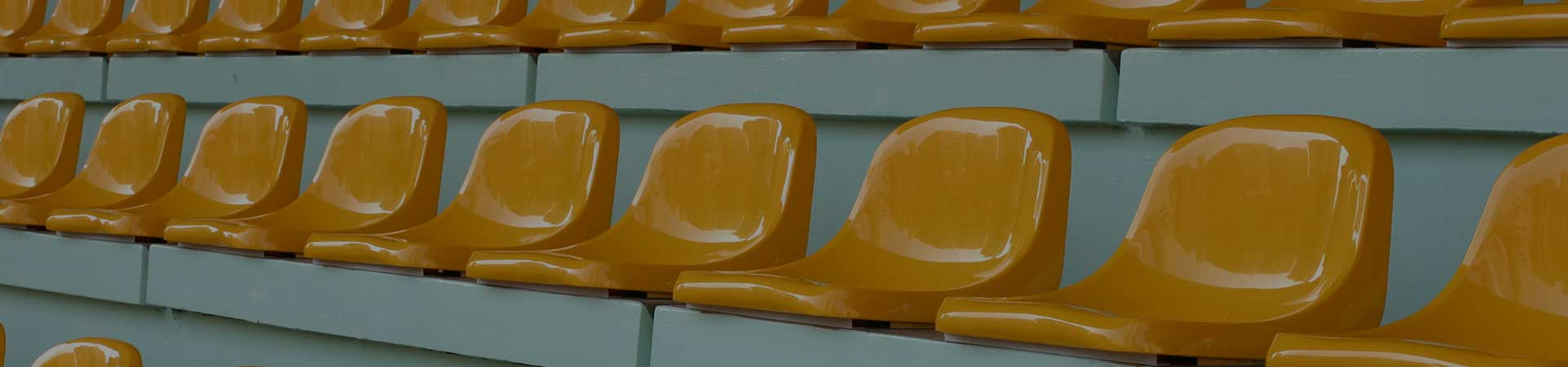 Yellow chairs in a stadium