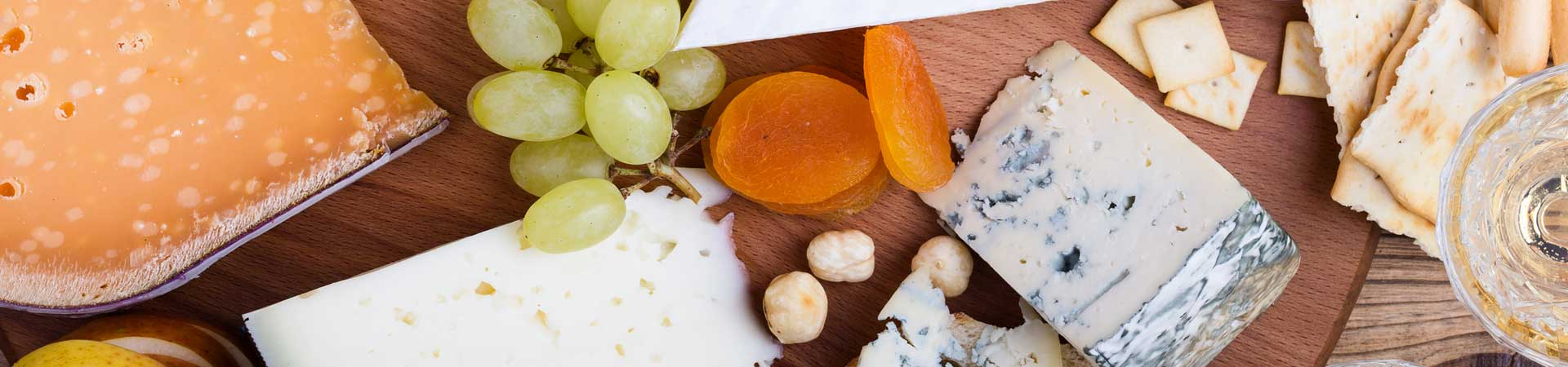 Cheese tray with wine and grapes